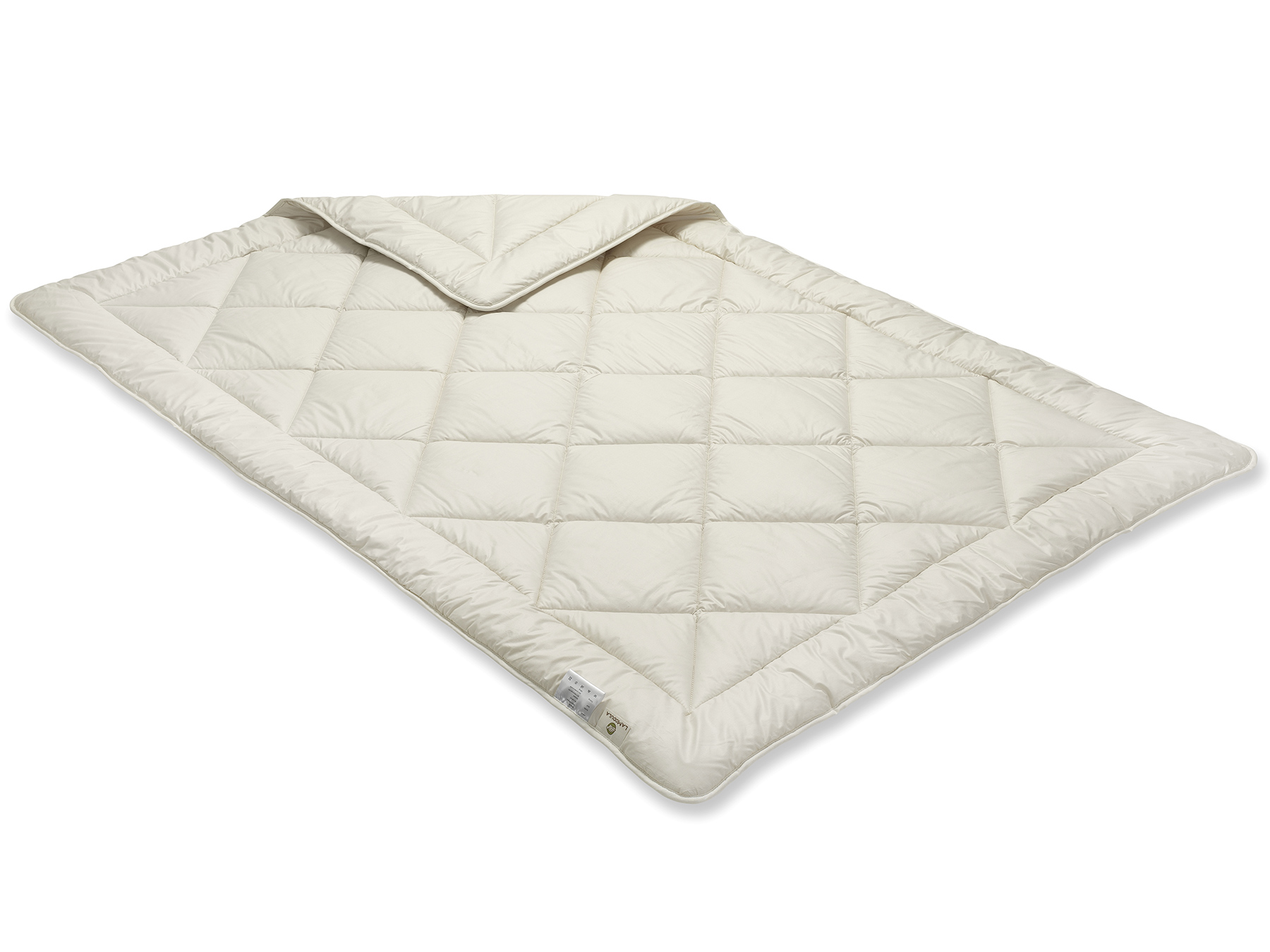 Durch das Füllmaterial schimmert die Decke gelblich, die Steppung entsteht durch die Einnadeltechnik.